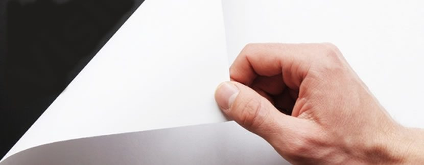 hand flipping a page of paper